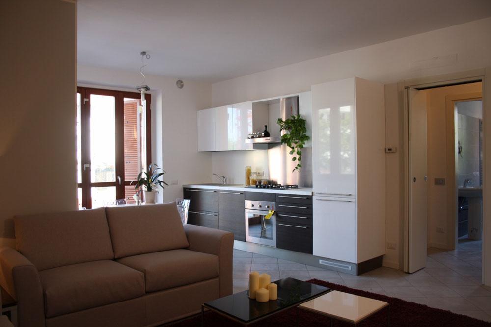Esempio arredamento con foto mobili su misura restelli for Foto di appartamenti arredati